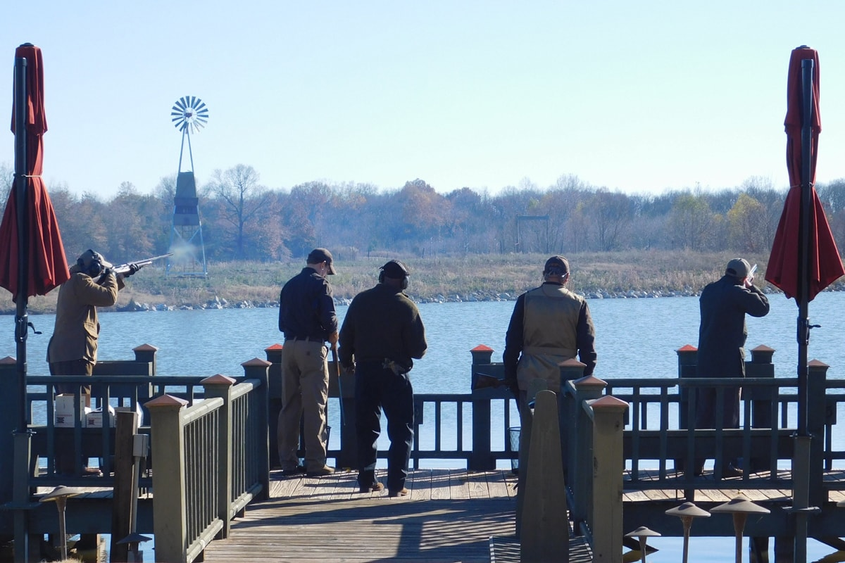 hunters on deck at lodge during sporting clays