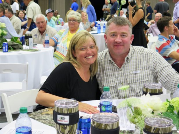 couple at auction dinner during cooking ribs for auction dinner event Mossy Oak Properties Fox Hole Shootout