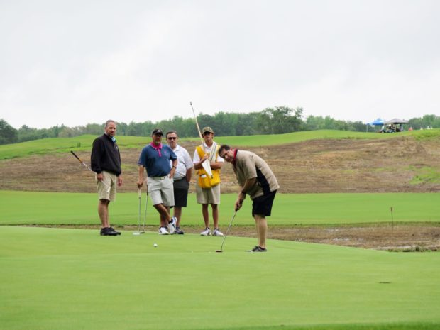 golfing in golf tournament at golf course at Mossy Oak Properties Charity Event