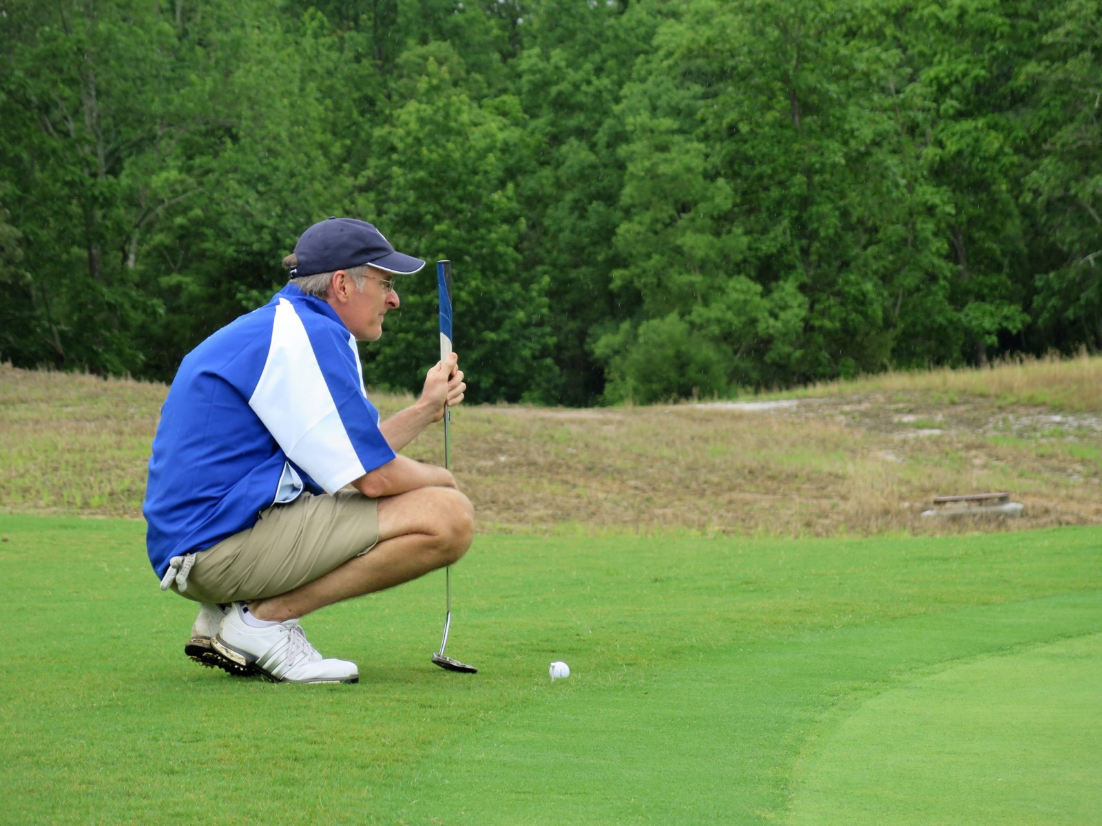 man golfer at golfing in golf tournament at golf course at Mossy Oak Properties Charity Event