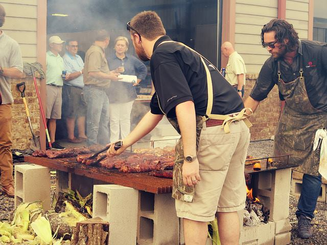 cooking ribs for auction dinner event Mossy Oak Properties Fox Hole Shootout