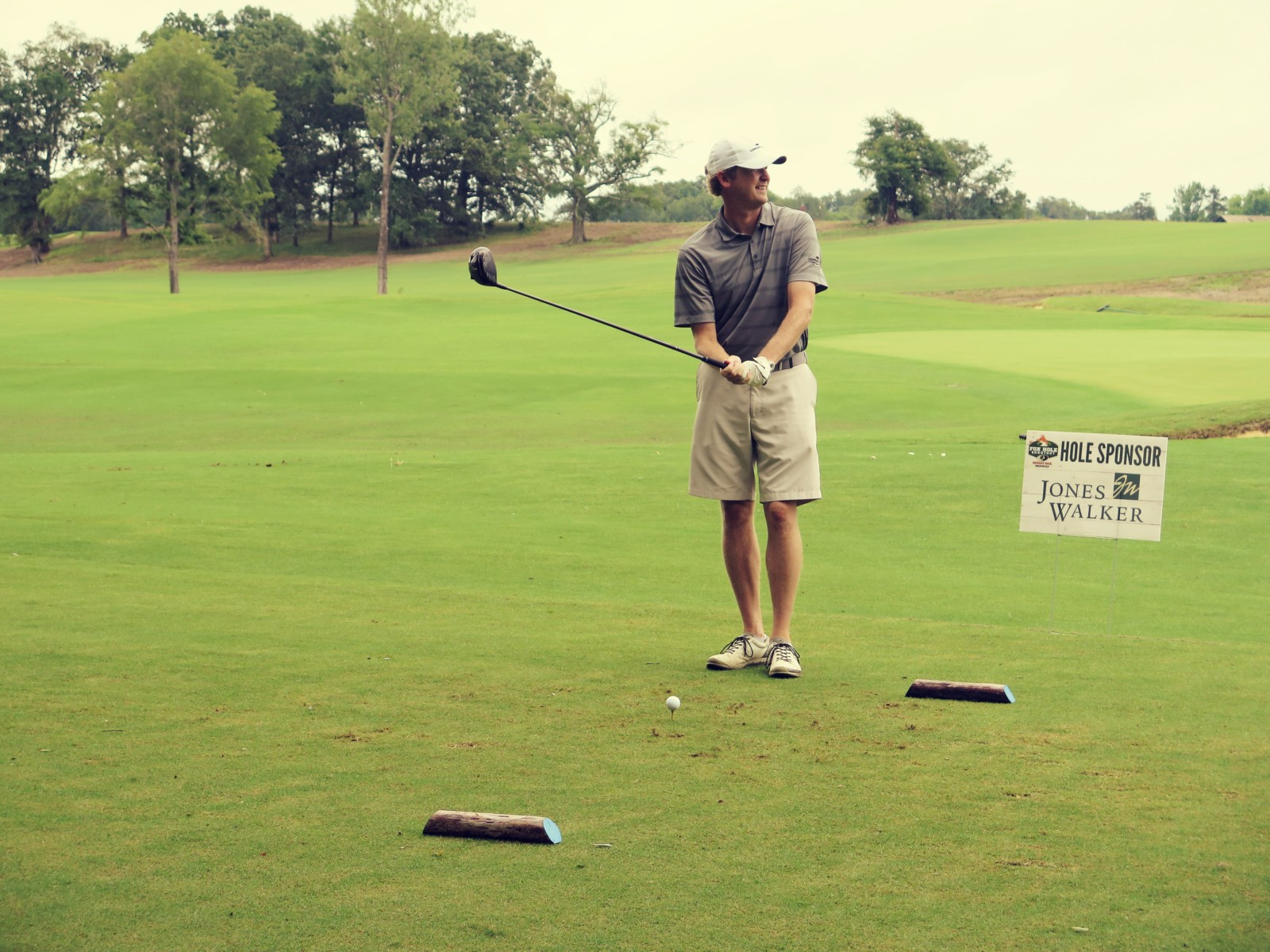 man in golf tournament at golfing in golf tournament at golf course at Mossy Oak Properties Charity Event