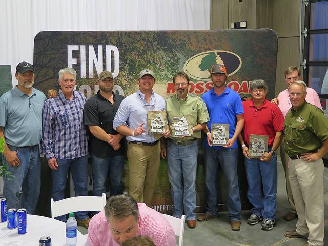 winners at auction dinner event mossy oak property golfing tournament
